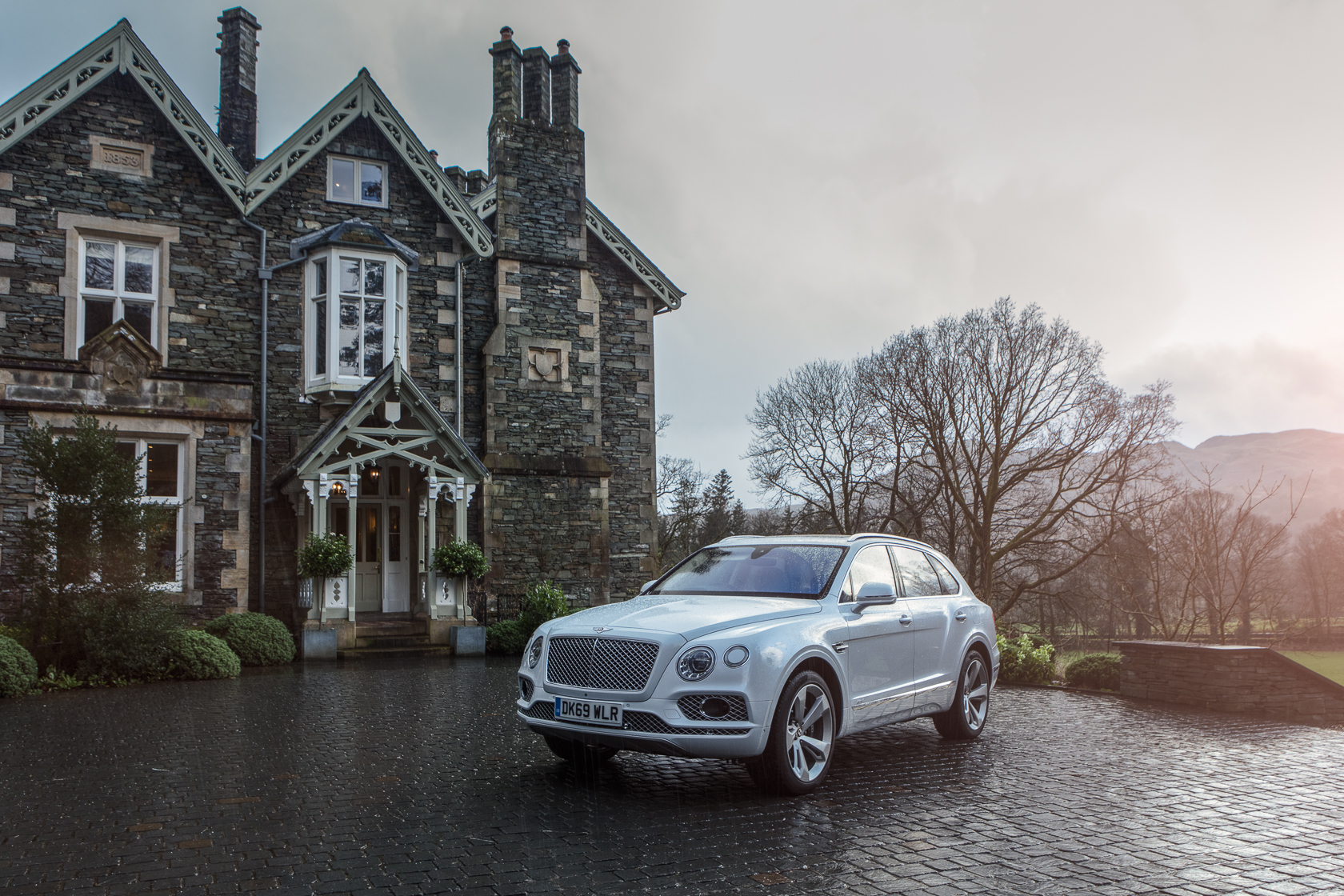 bentley bentayga at the forest side in grasmere